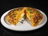 Tortilla de papa rellena con jamón y queso
