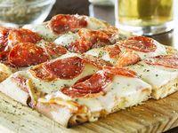 Pizza con muzzarella y 1 gusto