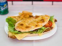 Promo - Sándwich de milanesa completo + papas fritas + Pepsi  500 ml