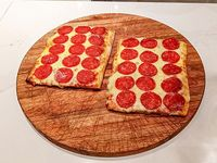 Promo 5- Porción pizza muzzarella con gusto 1+1