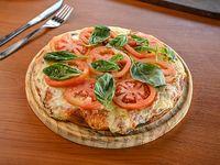 Pizzeta con muzzarella y un gusto