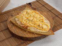 Porción de fainá a los cuatro quesos