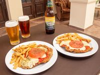 Promo - 2 Milanesas napolitanas con guarnición + cerveza Patagonia 730 ml