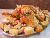 Pollo entero con papas y batatas