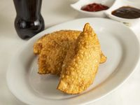 3 Empanadas de Pollo y Arroz + Una gaseosa 300 ml