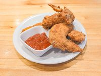 Alitas de pollo en salsa bbq o picante (12 unidades)