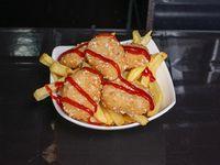 Bocaditos de pollo rebozados con salsa a elección