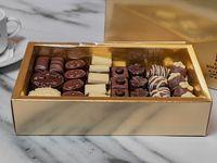 Bombones suizos surtidos caja dorada y bolsa de regalo 1 kg