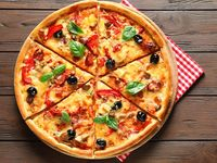 Pizza Entera Grande Tradicional + Gaseosa 1.5 Postobón