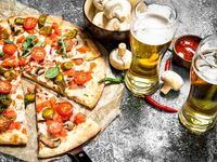 Pizza Mediana al Sartén + 2 Cervezas Heiniken (269ml)