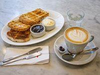 Integral - Café con leche o té + tostadas + queso y mermelada o dulce de leche
