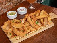 Chicken fingers + aros de cebolla + papas rústicas