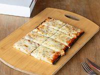 Pizza porción muzzarella