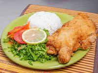 Pollo broaster con porción de arroz