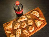 Promo - 12 empanadas + Coca Cola 1.5 L o Cervezas Andes