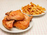 Pollo entero + fritas o ensalada mixtas