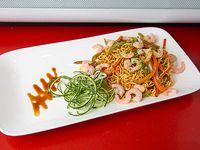 Wok de fideos de arroz con camarón