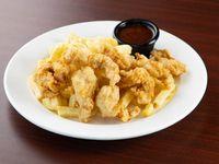 Deditos de pollo con papas fritas