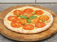 Pizza con cebolla y tomate