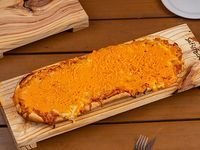 Pizzeta con queso cheddar (50x20 cm)