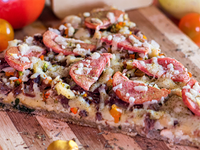 Pizza La Rola en Porción