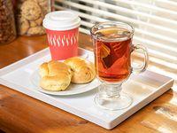 Promo desayuno - Café, té o café con leche + 2 medialunas