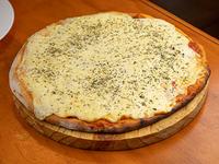Pizzeta con muzzarella y orégano sin fainá