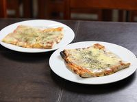 Pizza con muzzarella (2 x 1)
